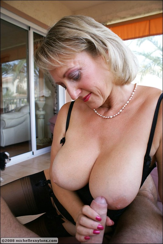 Showing images blonde mature give black photo 4